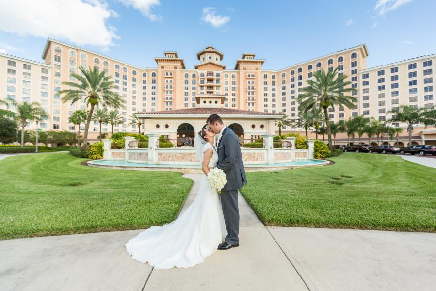 Bride and Groom in front of Rosen Shingle Creek®