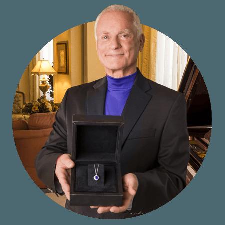 Mr. Harris Rosen Holding Sapphire Necklace